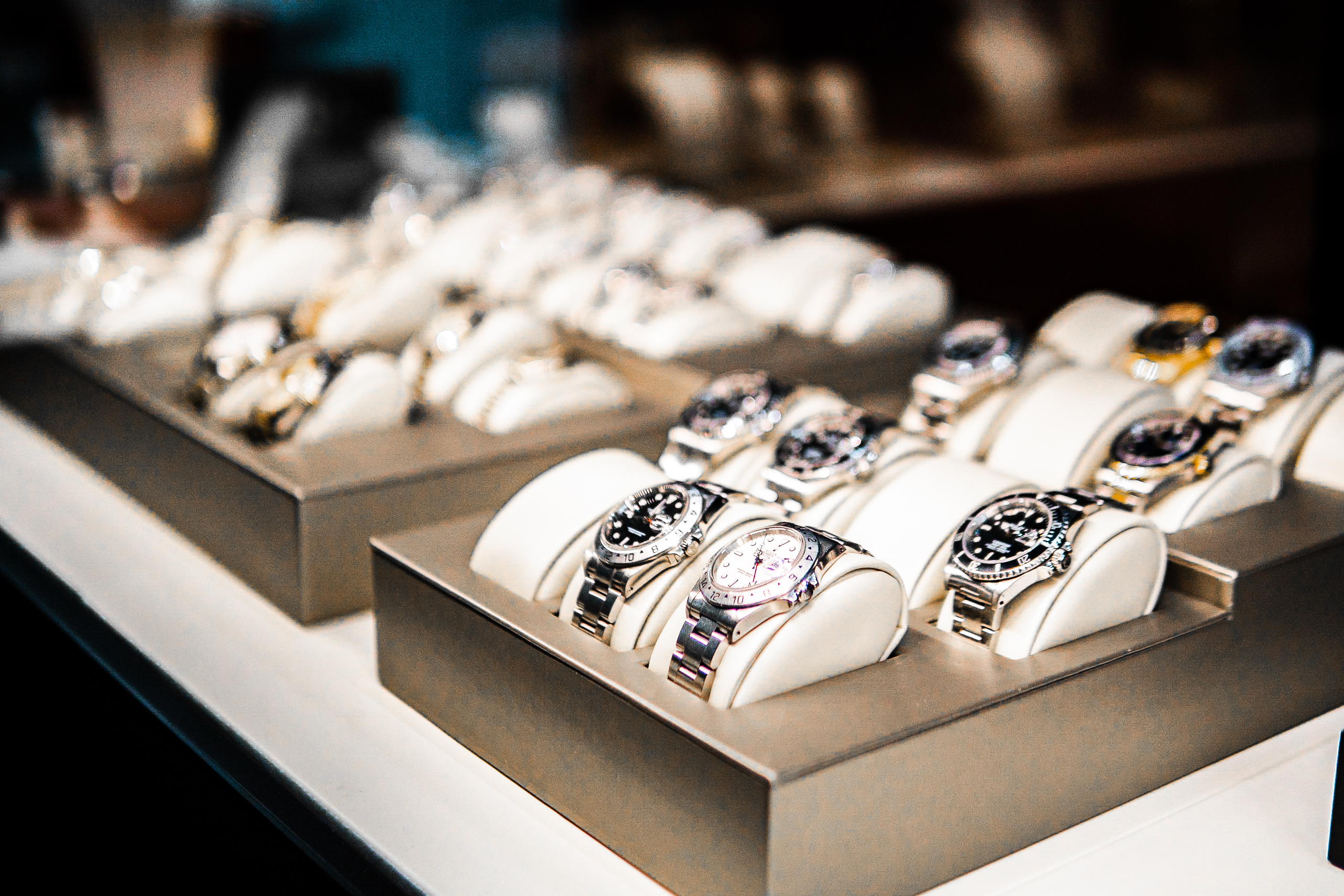 Up close photo of many luxury watches in store case